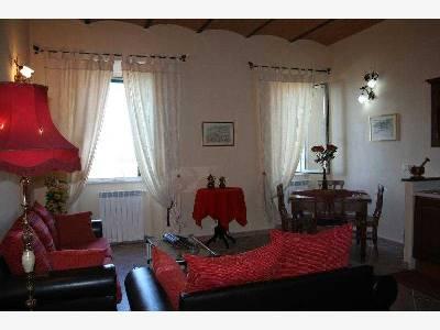 Квартира в Порто Санто Стефано - гостиная